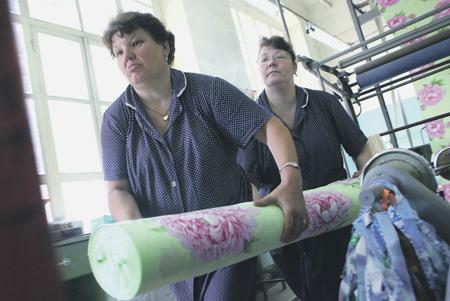 Россияне теперь зарабатывают в долларовом выражении меньше, чем китайцы.Фото Григория Тамбулова (НГ-фото)