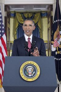 Телеобращение президента США транслировалось телеканалами в прайм-тайм. Фото Reuters